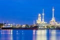 Oil refinery and transportation ship river front Royalty Free Stock Photo