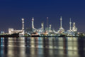 Oil refinery at twilight with river reflexion panorama of along Royalty Free Stock Photo