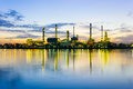 Oil refinery at twilight sun rise time on the riverview Royalty Free Stock Photography