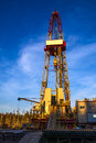Oil rig at background dawn . Royalty Free Stock Photo
