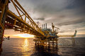 Oil and rig platform in the sea offshore petrolium society Royalty Free Stock Photo