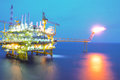 Oil and rig platform in sunset or sunrise time Royalty Free Stock Photography