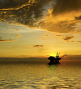 Oil Rig silhouette with majestic ocean and sunset Stock Images