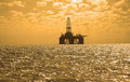 Oil rig during sunset in Caspi Stock Image