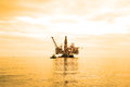 Oil rig during sunset hours Royalty Free Stock Image