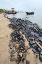 Oil spill contaminated beach in chonburi thailand Stock Images