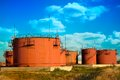 Oil storage organized tanks of petroleum products on the background of the cloudy sky Royalty Free Stock Photos