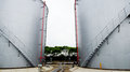 Oil storage tank large gray open air petroleum liquid is a good helper for storing liquid Stock Photo