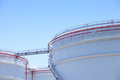 Oil storage tanks with blue sky Stock Images