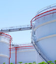 Oil storage tanks with sunshine Royalty Free Stock Images
