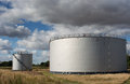 Oil storage tanks under a cloudy sky Stock Photography