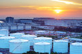 Oil tanks for cargo service during sunset Royalty Free Stock Images