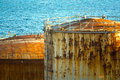 Oil tanks view of old rusty of a refinery factory near the sea Royalty Free Stock Image