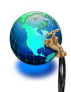 Oil tap on world globe Royalty Free Stock Photos