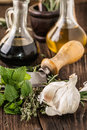 Oil and vinegar, gralic, knife and herbs Royalty Free Stock Photo