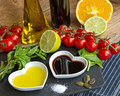 Oil and vinegar in heart shaped bowls displayed with fresh produ Royalty Free Stock Photo