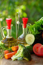 Oil vinegar and vegetables. Royalty Free Stock Photo