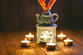 The oil warmer in the candles Royalty Free Stock Photo