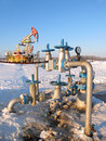 Oil well pump jack in work industry and gas industry in west siberia latch on a Stock Images