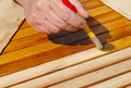 Oil wood furniture wooden table is painted protection Stock Photo