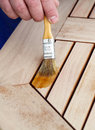 Oil wood furniture wooden table is painted protection Royalty Free Stock Images