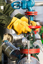 Oil worker turning valve Royalty Free Stock Photo