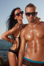 Oiled perfect bodies couple posing Stock Images