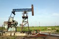 Oilfield with pump jack and pipeline Stock Photography