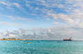 OISTINS, BARBADOS - MARCH 15, 2014: Miami Beach Landscape with Ocean Water Blue Sky and Boats,  Oil Chemical Tanker Royalty Free Stock Photo
