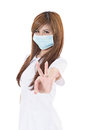Ok gesture asian nurse wear mask and give you an sign closeup portrait on white background Royalty Free Stock Image
