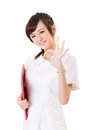 Ok gesture asian nurse woman give you an sign closeup portrait on white background Stock Photos