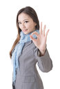 Ok gesture by business woman of asian on white background Royalty Free Stock Photo