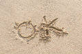 OK - sand writing on the beach Stock Photography