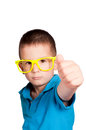 Ok sign little boy showing with his hand selective focus on the boy head Royalty Free Stock Image