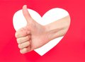 Okay gesture woman hand shows against red heart Stock Images