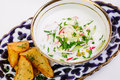 Okroshka - a traditional Russian soup from cucumbers, radishes, Royalty Free Stock Photo