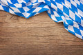 Oktoberfest background blue checkered fabric on wooden Stock Photography