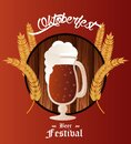 Oktoberfest celebration festival poster with beer cup and barley spikes Royalty Free Stock Photo