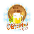 Oktoberfest design with mug of beer, wooden barrel, barley spikes and hops on blue and white diamonds background. Royalty Free Stock Photo