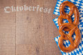 Oktoberfest German beer festival background with pretzel
