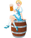Oktoberfest girl on the keg german sits and holds mug Stock Image