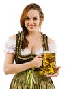 Oktoberfest girl photo of a beautiful female waitress wearing traditional dirndl and holding a huge beer over white background Stock Photography