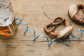 Oktoberfest masskrug of beer pretzels and bavarian streamer on rustic wooden table Royalty Free Stock Images