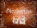 Oktoberfest sign, beer mugs, chalk drawings, wooden background