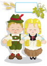 Oktoberfest small couple celebrating with beer mugs Stock Images