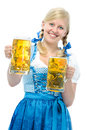 Oktoberfest smiling woman with dirndl holds beer steins Royalty Free Stock Image