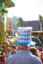 Oktoberfest tourist funny with bier hat on in munich Royalty Free Stock Photo