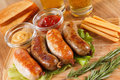 Oktoberfest traditional beer menu. Fried sausages with toast and mustard. Royalty Free Stock Photo