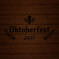Oktoberfest 2017. Wooden background with Oktoberfest 2017 typography wheat and beer glass