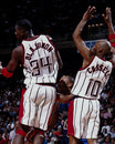 Olajuwon and cassell houston rockets center hakeem guard sam image taken from the color negative Stock Images